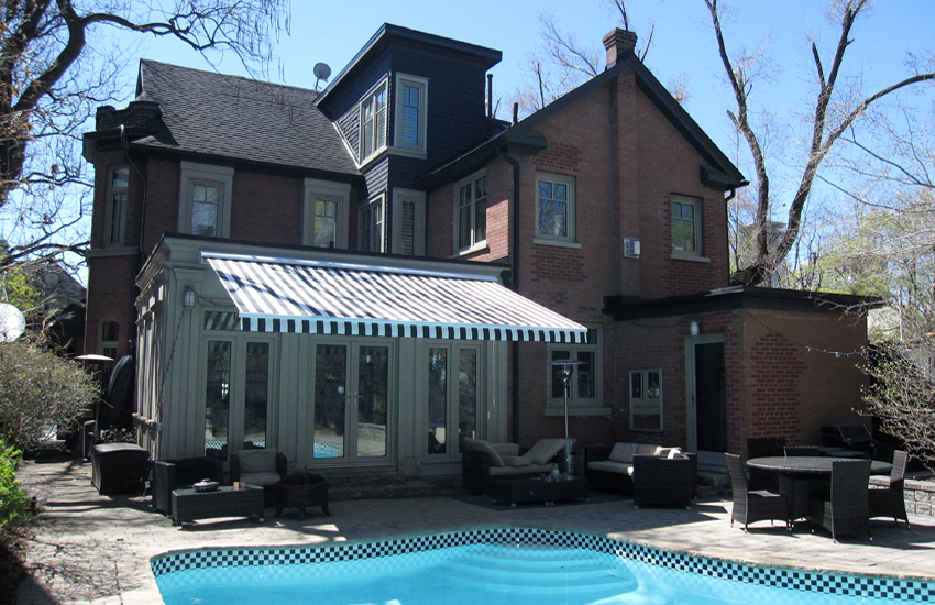 Awning by the pool of Victorian style house