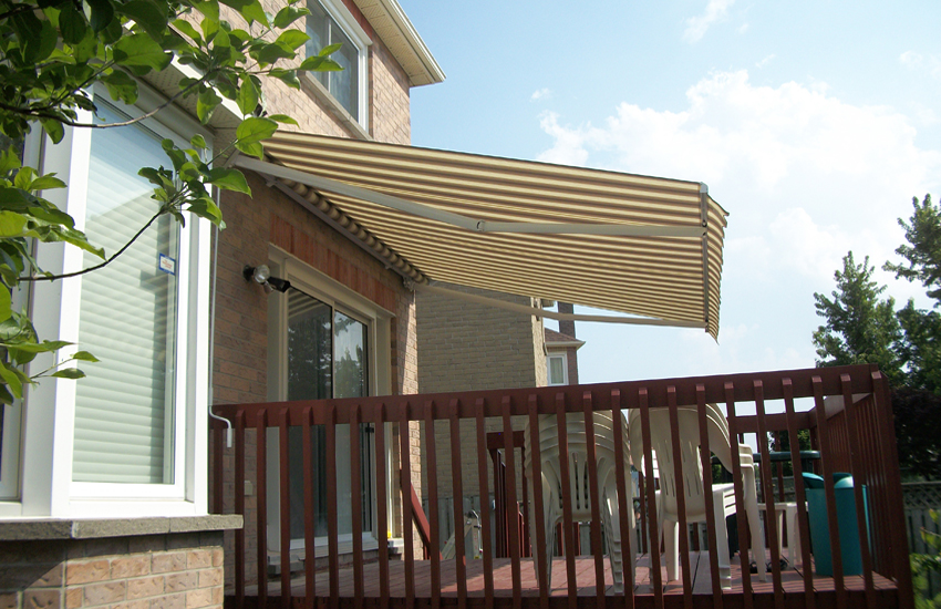 Cream awning over auburn deck