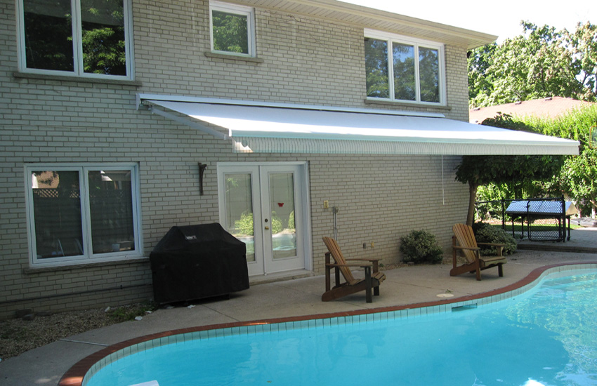 Light striped awning over pool