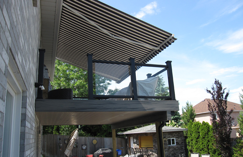 Roof mounted semi cassette awning